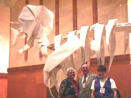 The McNitt family in front of the life sized Triceratops skeleton (created by Yoshino, folded by D-Team)